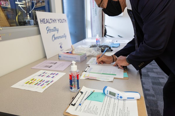 The Superintendent goes through health screening